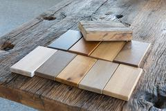 Samples of different kinds of wood in a furniture shop Stock Photos