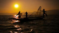 Video FullHD - Silhouettes of fishermen at sunset. Ends fishing in the tradit Stock Footage