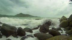 Storm tropical sea. Waves and rocks - stock footage