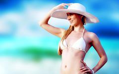 Young beautiful women on the sunny tropical beach in bikini and Stock Photos