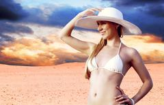 Young beautiful women in whitebikini and hat, relaxation at sunn Stock Photos