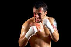 Aggressive boxer with blood on the face Stock Photos