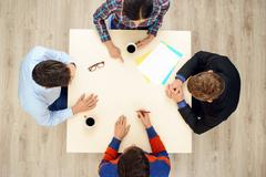 Top view table with group of creative people - stock photo