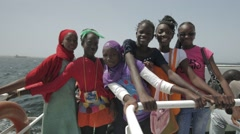 Girls travelling from Dakar to Goree Island on a Ferry Stock Footage