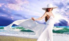 Young beautiful women in the white with pareo on the sunny tropi Stock Photos