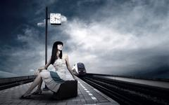 Stock Photo of Girl waiting train on the platform of railway station