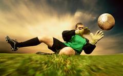 Stock Photo of Jump of football goalman on the outdoor field