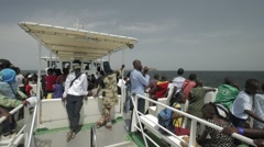 Passengers on a Ferry joining Goree Island Stock Footage