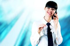 Stock Photo of Hapiness Businesswoman standing on the business background