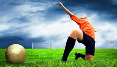 Stock Photo of Happiness footballer - outdoor