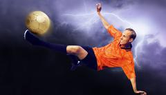Shoot of football player on the sky with clouds Kuvituskuvat