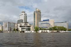 Amsterdam office buildings along the river Amstel in The Netherlands - stock photo