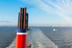 Chimney at a ship sailing a a blue sea Kuvituskuvat