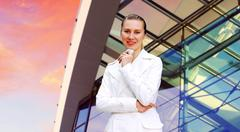 Happiness businesswoman on the business architecture background - stock photo