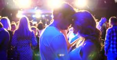 Young couple dancing on a disco dance floor - stock footage