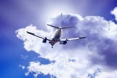 Stock Photo of Airplane on the blue sky
