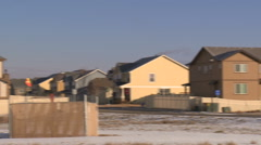 Pan across neighborhood fracking operation Stock Footage