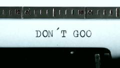 Typewriter. Typing text: don´t goo - stock footage