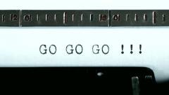 Typewriter. Typing text: go go go !!! Stock Footage