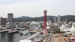 Kobe Harbor with Kobe Tower and mountains Stock Footage