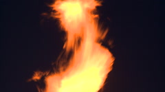 Tilt down on gas flare at night Stock Footage
