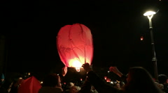 People releasing paper lanterns Stock Footage