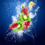 Drops around fruits under water - stock photo