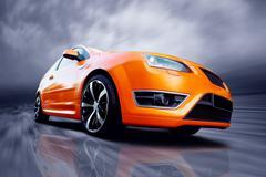 Stock Photo of orange sports car going fast