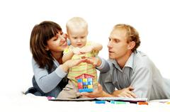 Stock Photo of Happiness child with parents paint