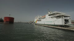 A white ferry dock at the Port of Dakar, Senegal Stock Footage