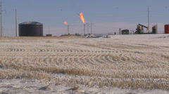 Stock Video Footage of snowy fracking operation site