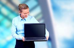 Happiness businesswoman with laptop on blur business architectur Stock Photos