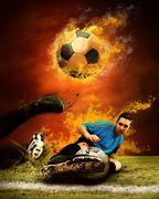 Stock Photo of Football player in fires flame on the outdoors field