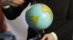 Desk globe rotating in hands Stock Footage