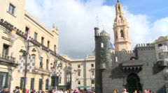 Main square with a fake castle, pan right from the city hall Stock Footage