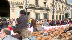 People walking on the parade course before starting, chairs in line Stock Footage