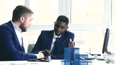 Young people are messy discuss something. One of the businessmen - African - stock footage