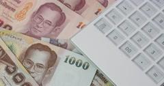 4k rotating thailand Baht money & calculator. Stock Footage