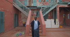 Man pictured in front of his house, Goree, Senegal (4K) - stock footage