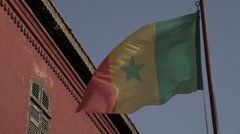 The national flag of Sengal waving in the Island of Goree, Senegal Stock Footage