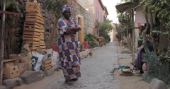 A lady standing in front of her shop, Goree, Senegal (4K) Stock Footage