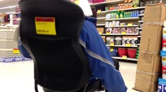 Man trying new office chair Stock Footage