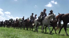Battle of Gettysburg 150th Anniv. - Confederates on horseback crossing field Stock Footage