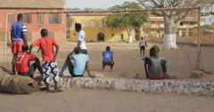 Men playing football, Goree, Senegal (4K) Stock Footage
