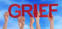 Many People Hands Holding Red Straight Word Grief Blue Sky - stock photo