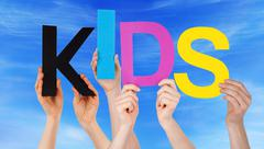 Many People Hands Holding Colorful Word Kids Blue Sky - stock photo