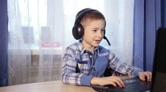 Baby talking on the internet, the boy talks to friends on the computer, video Stock Footage