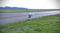 Flying Quadrocopter at the airport Stock Footage