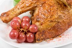 Half roasted chicken closeup Stock Photos