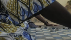A man playing Checkerbord with friends, Goree, Senegal Stock Footage